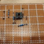 Placed parts on a piece of stripboard.